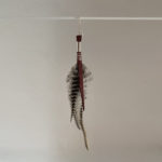 Grizzly and white rooster feather